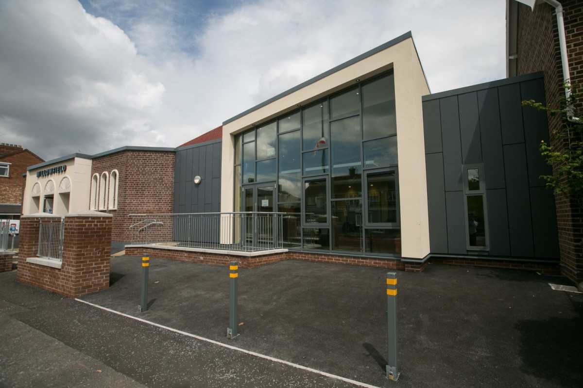 Willowfield church Belfast, Built and installed by Maurice Flynn Contractors. Swisspearl 12mm fibre cement cladding, colour Carat 7021, concealed fixing. Architect Samuel Stevensons. - Fibre Cement Cladding